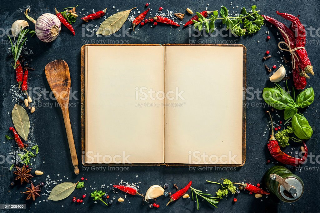 Herbs and spices with a recipe book stock photo