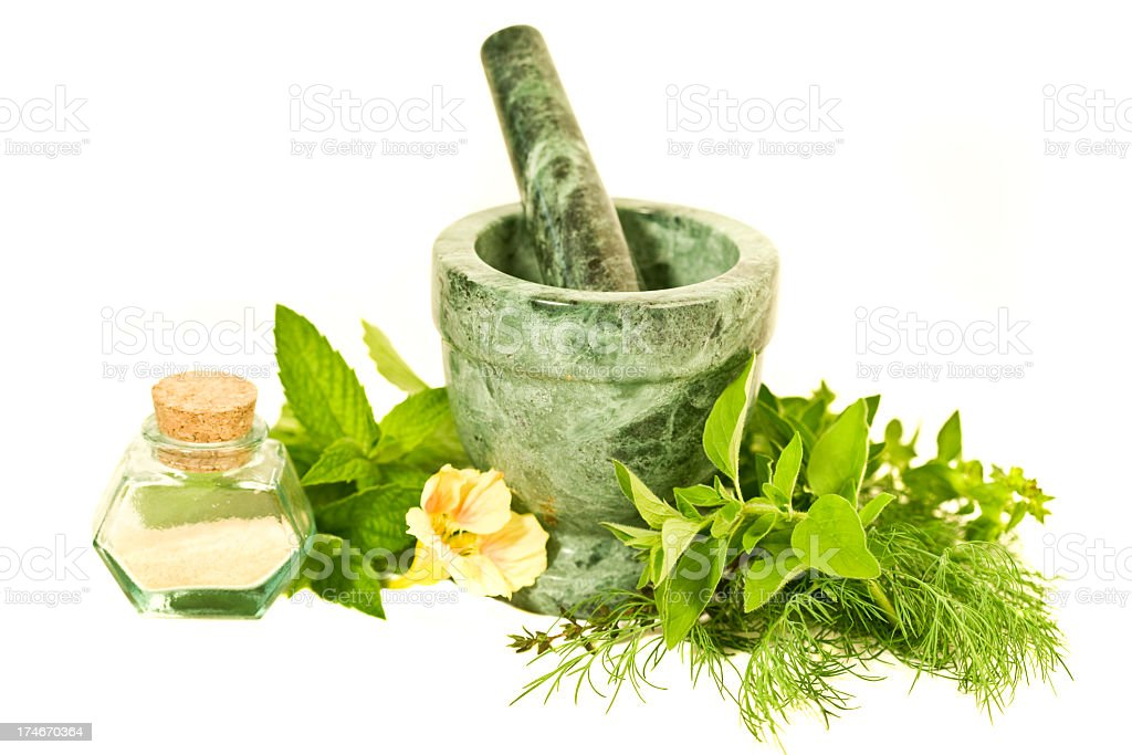 Herbs in a stone bowl with oils and fresh cut herbs royalty-free stock photo