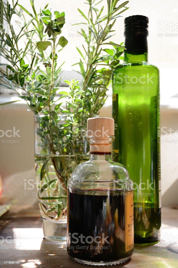 herbs, oil, and vinegar stock photo