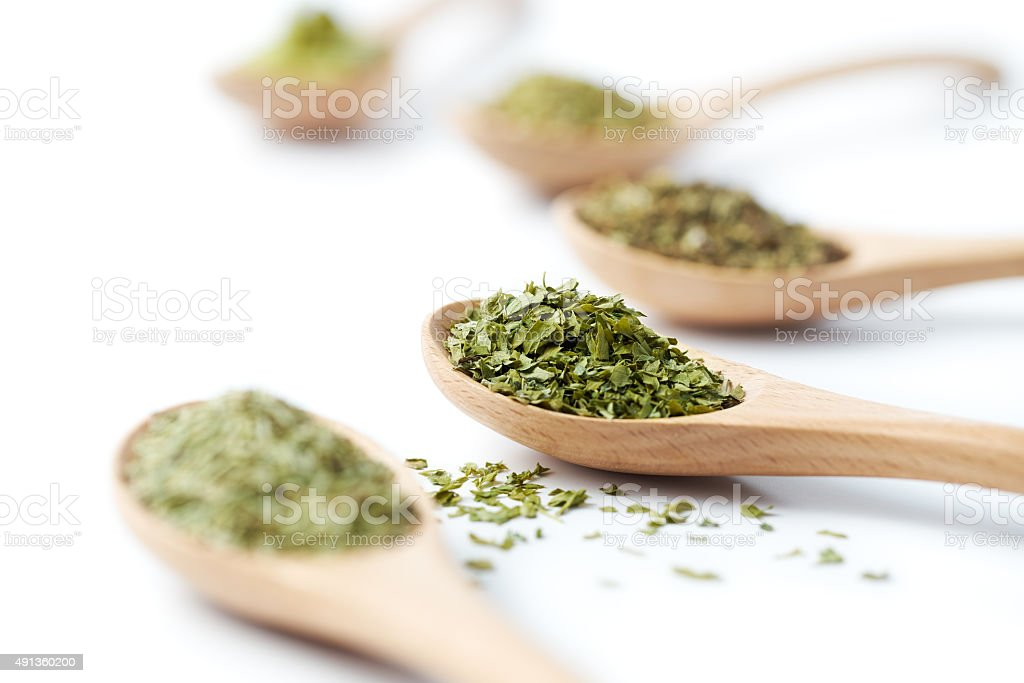 Herbs on Wooden Spoons stock photo