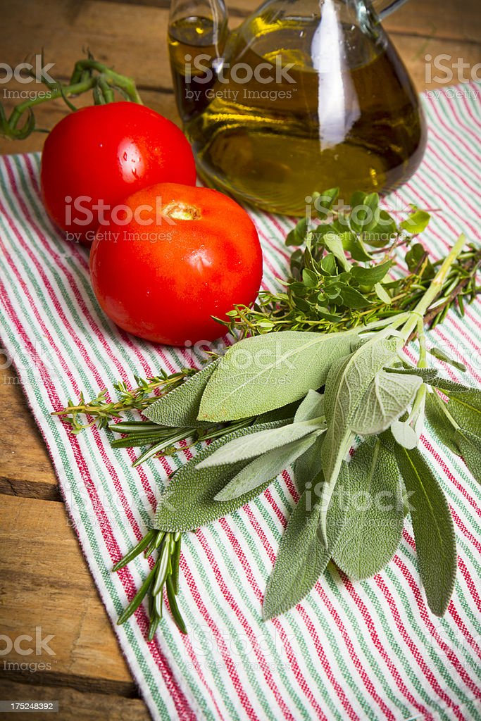 Herbs, Tomatoes and Olive Oil royalty-free stock photo