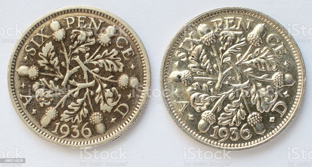 Two 1936 sixpences difference in wear reverse stock photo