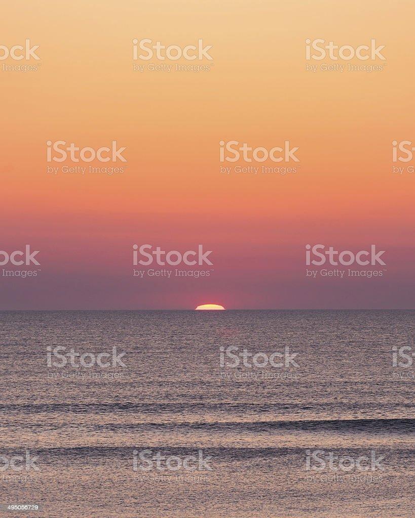 Here Comes the Sun in Orange and Purple! stock photo