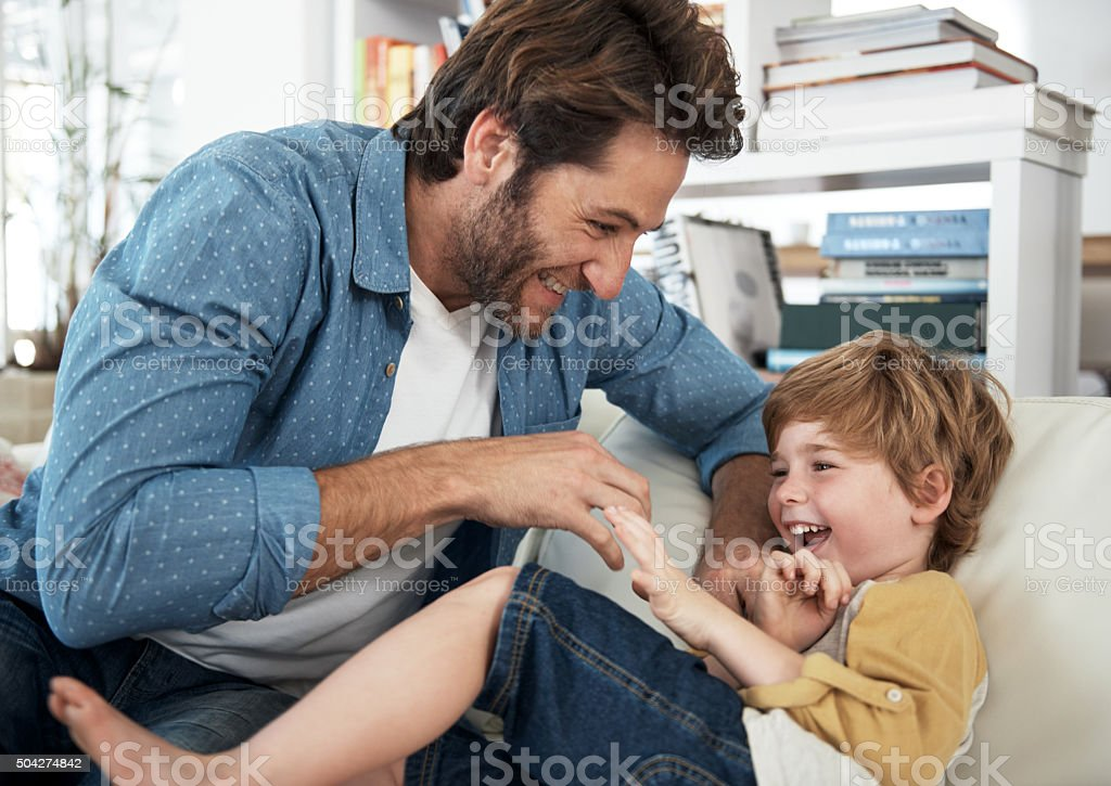 Here comes the tickle monster! stock photo