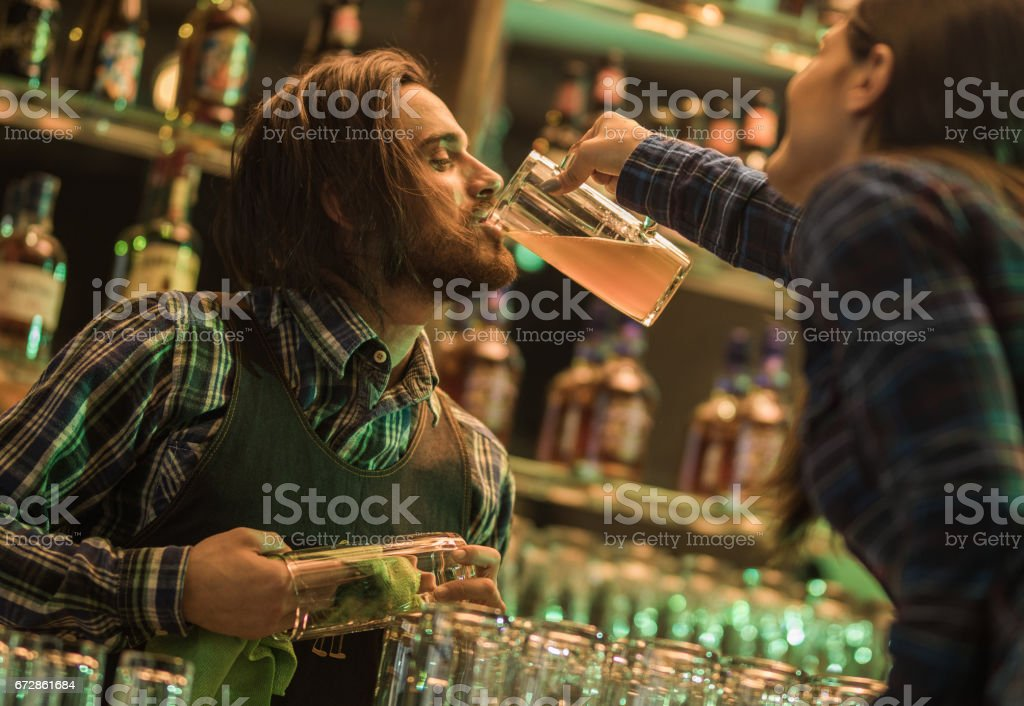 Here, take a sip from my glass! stock photo