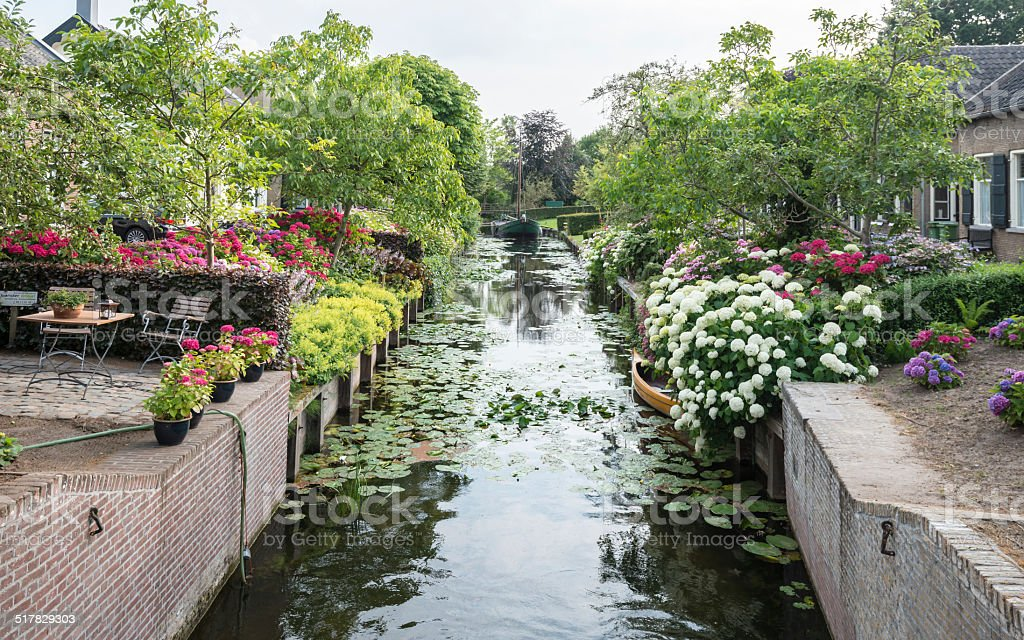 Herengracht canal with historic houses in a Dutch village stock photo