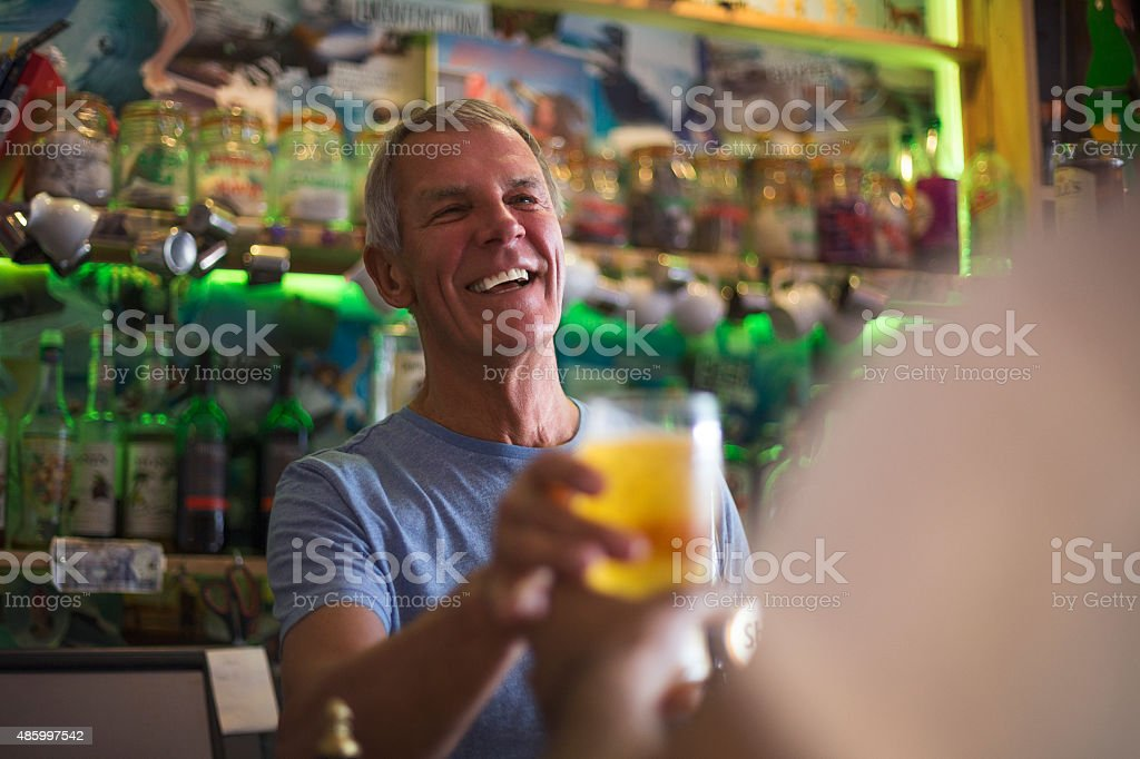 'Here's your pint, sir!' stock photo