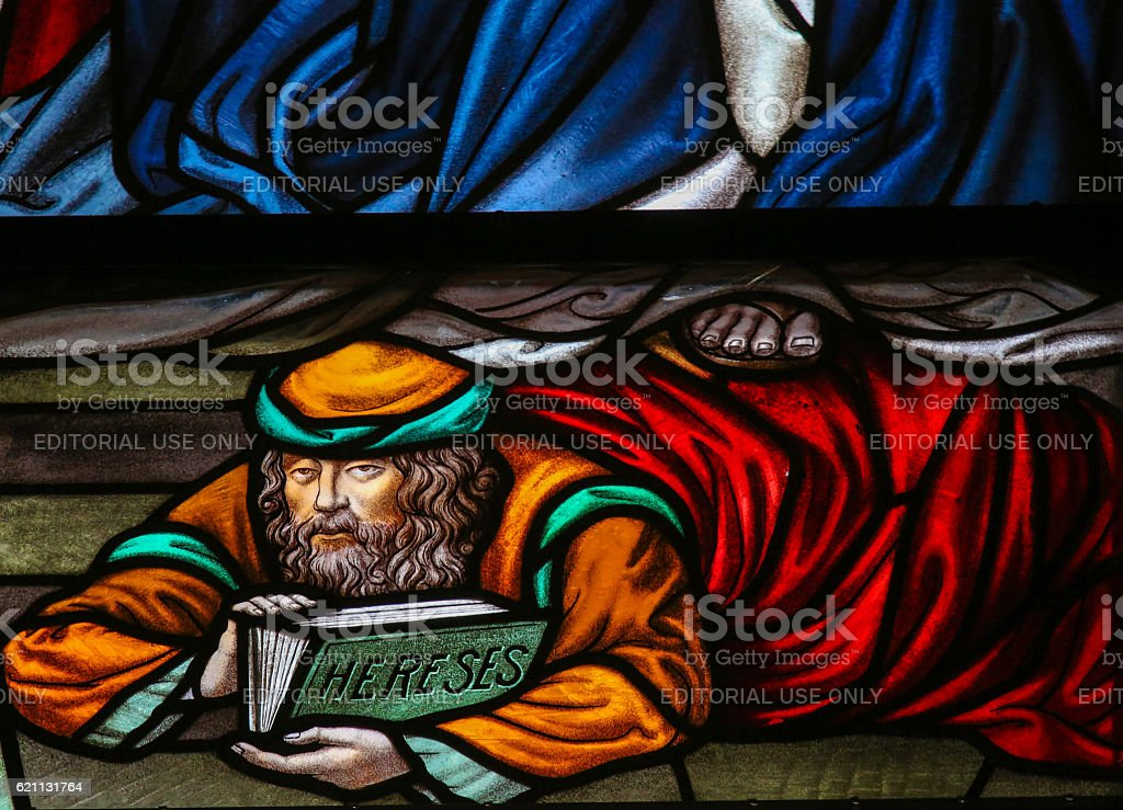 Heretic - Stained Glass in Mechelen Cathedral stock photo