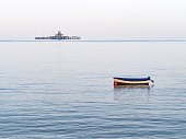 Herne Bay pier remains and boat.