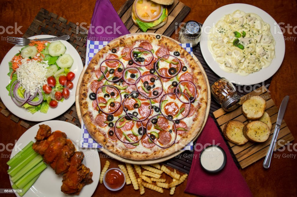 Hero Shot Of Italian Food Pizza And Chicken Wings stock photo