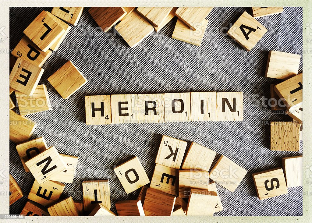 Heroin Spelled with Scrabble Tiles stock photo