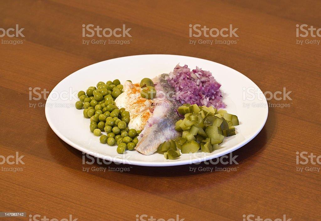 herring in Öle mit Gemüse Lizenzfreies stock-foto