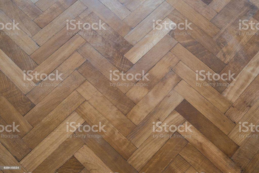 herringbone parquet floor - old wooden floor stock photo