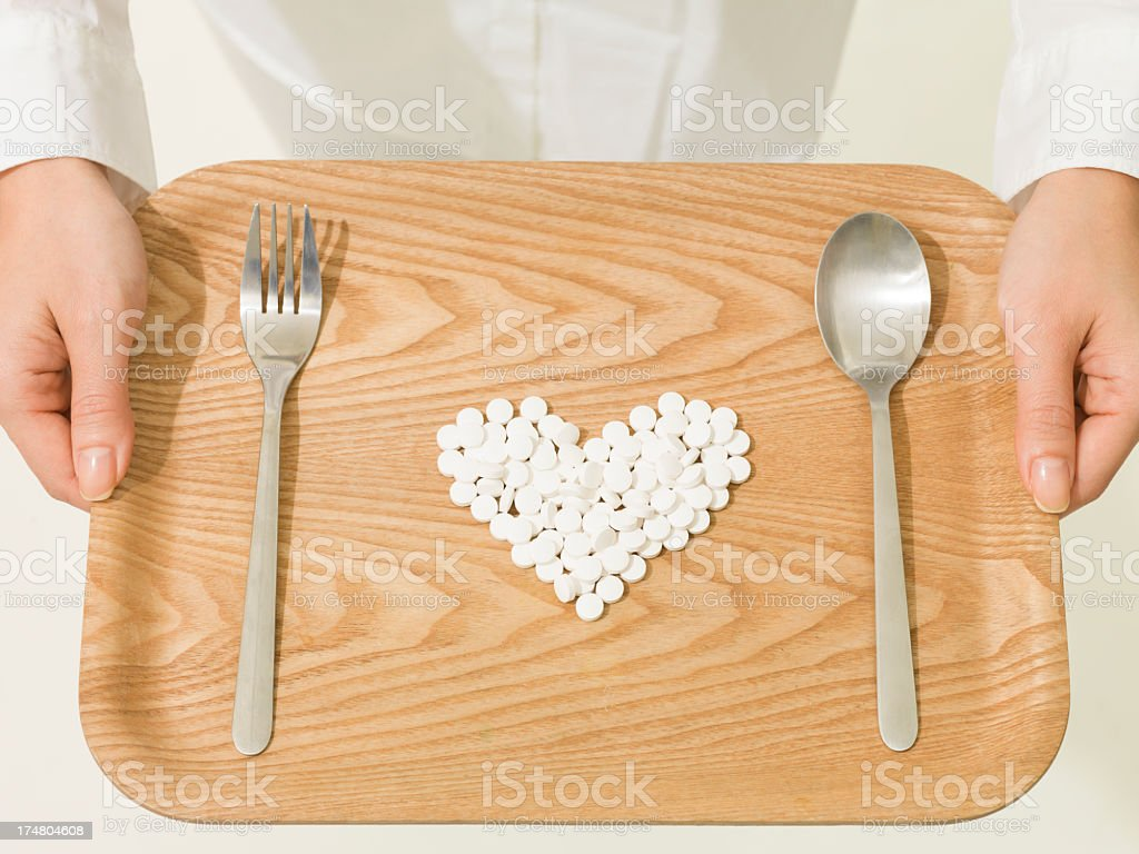 hert shape medicine on the tray royalty-free stock photo