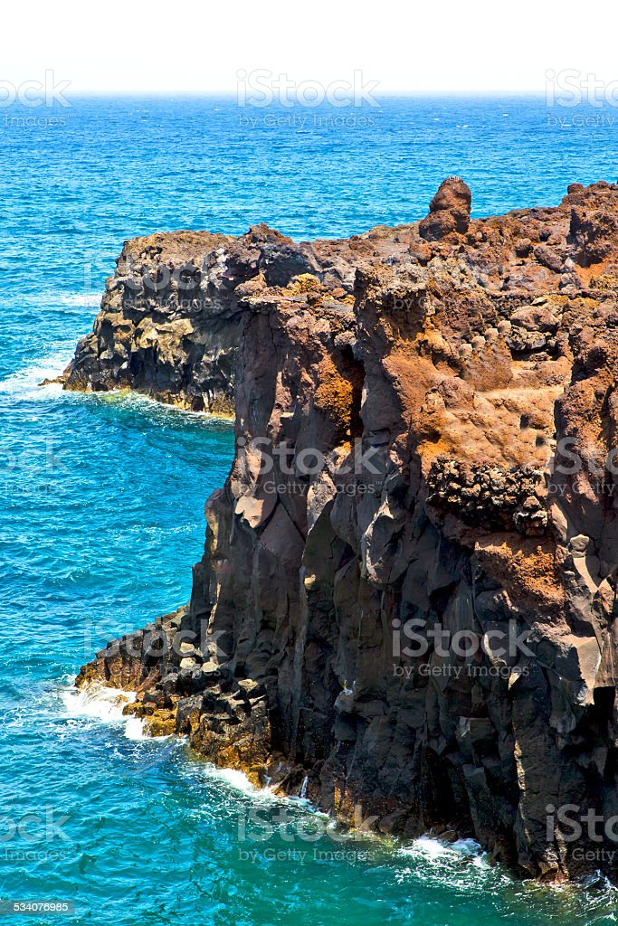 hervideros brown rock in   and summer stock photo