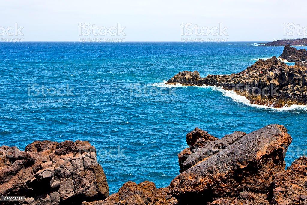 hervideros brown rock in white coast lanzarote    ummer stock photo