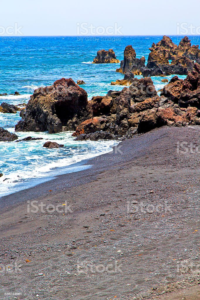 hervideros brown rock in white coast   water   summer stock photo