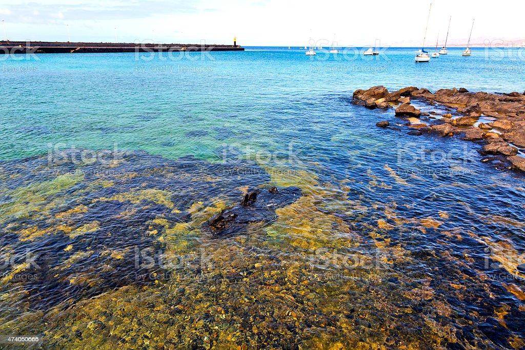 hervideros brown rock in white coast yacht stock photo