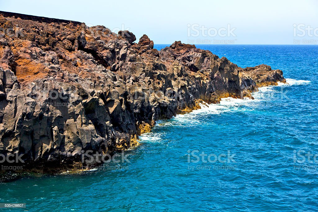 hervideros brown rock in white stock photo