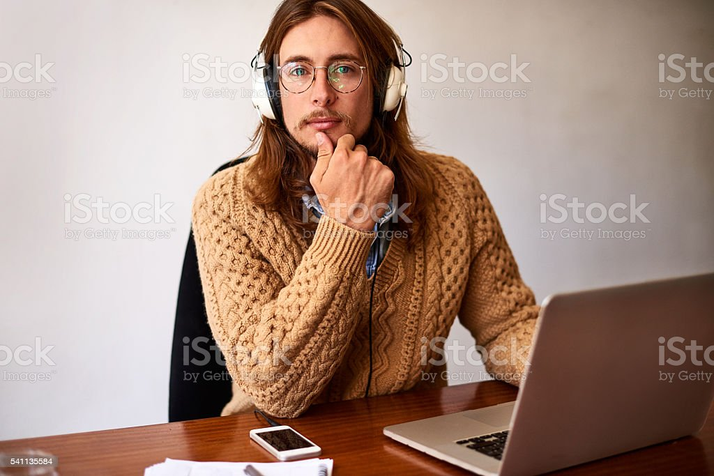 He's a focused young design professional stock photo