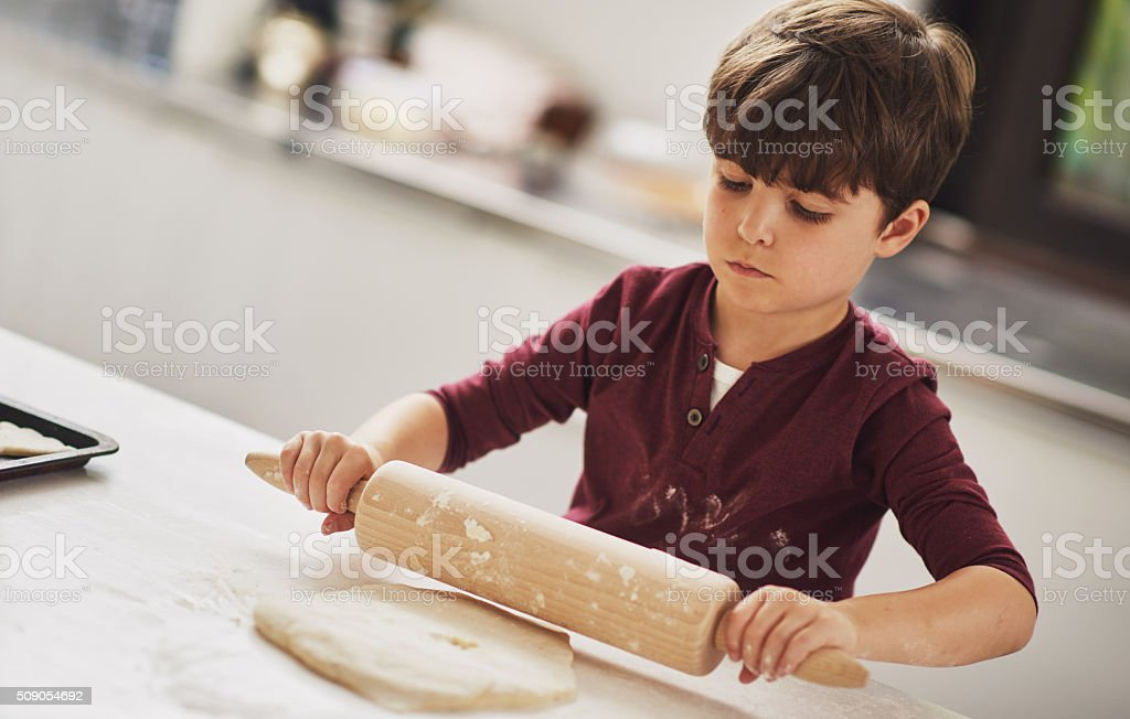 He;s a natural born baker! stock photo