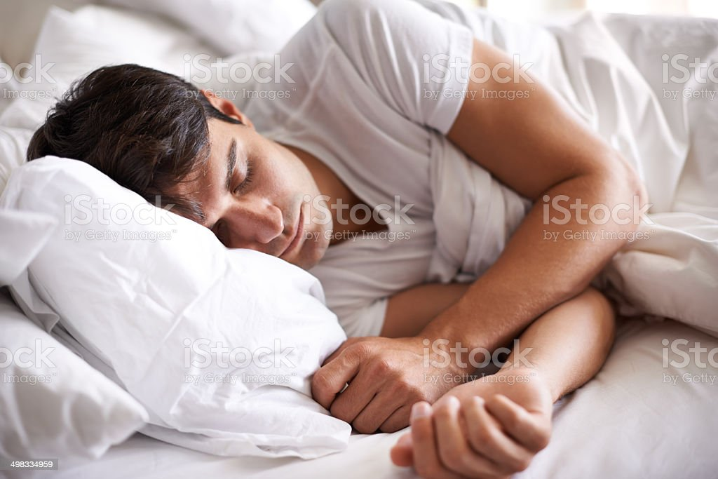 He's a peaceful sleeper stock photo