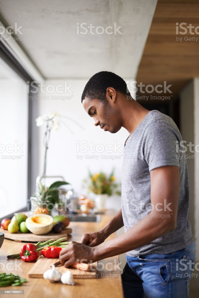 He's adding a little color to his meal stock photo