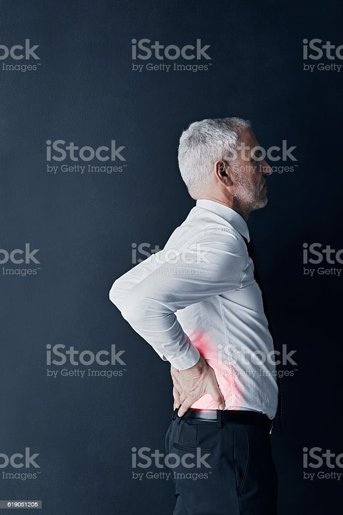 He's been at his desk for much too long stock photo