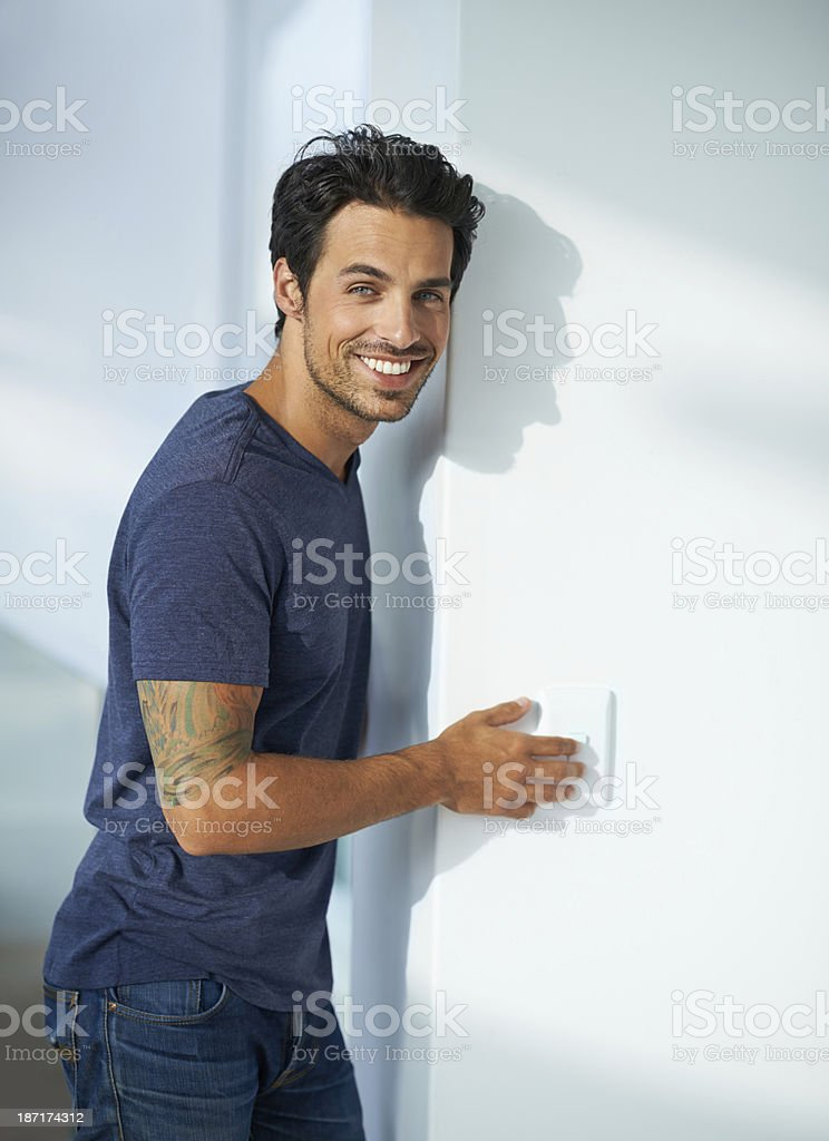 He's eco conscious - turning of his lights stock photo