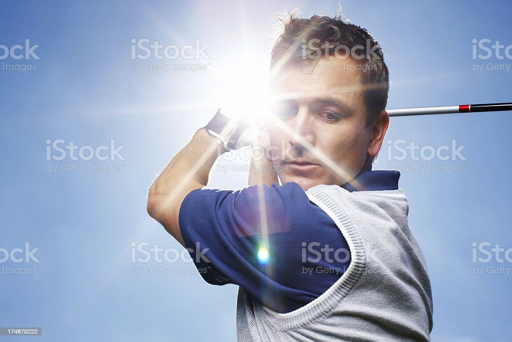 He's focused on his swing royalty-free stock photo