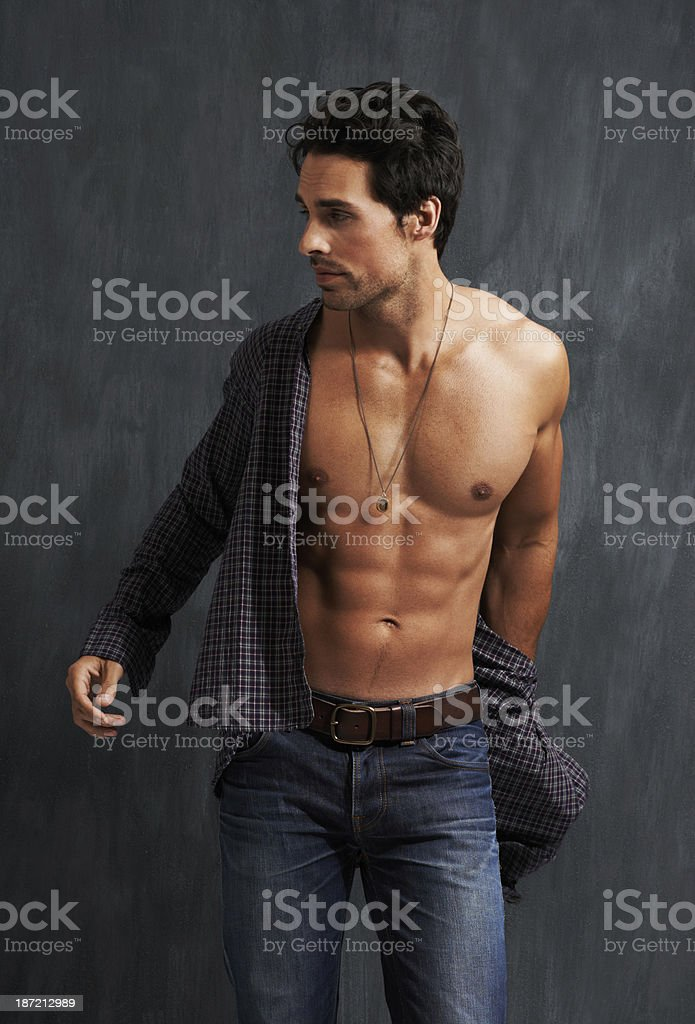 He's getting dressed to go out stock photo