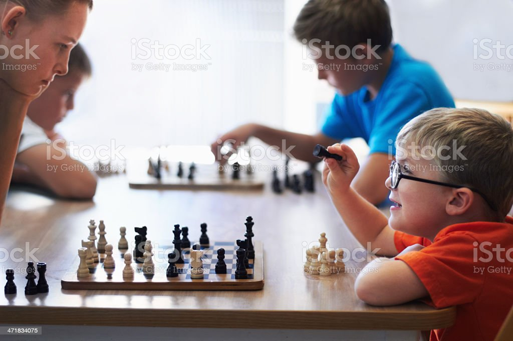 He's going to be a chess champion stock photo