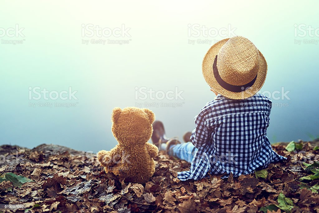 He's got a friend in teddy stock photo