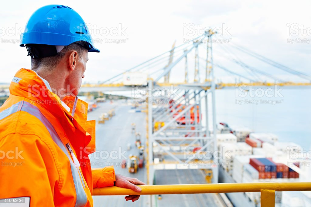 He's got a great view of the entire dock stock photo