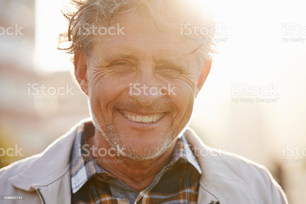 He's got a sunny outlook on life stock photo