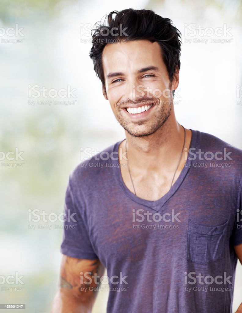 He's got charm to go with those good looks stock photo