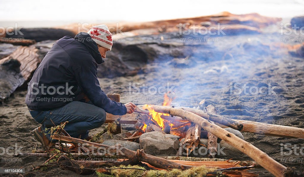 He's in charge of the campfire stock photo