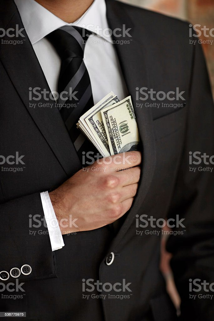 He's not above accepting a bribe stock photo