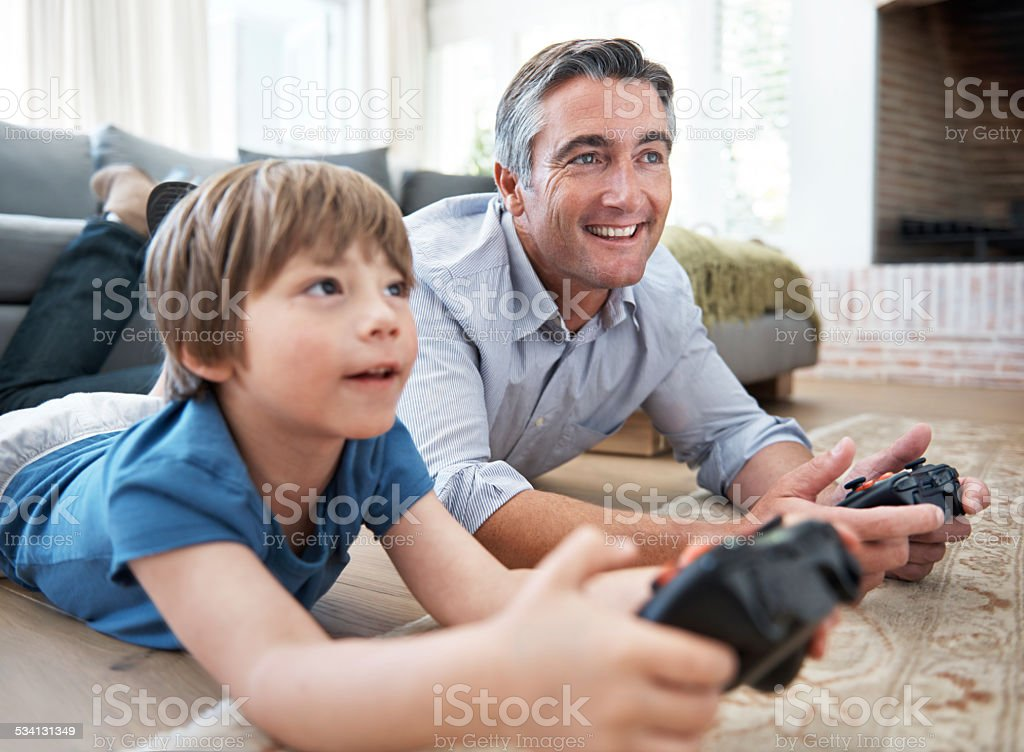 He's really into this video game stock photo