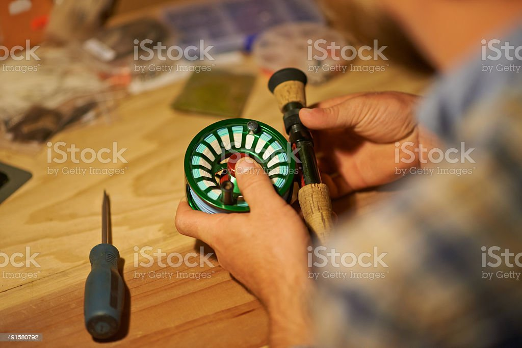 He's reel precise when it comes to his gear stock photo