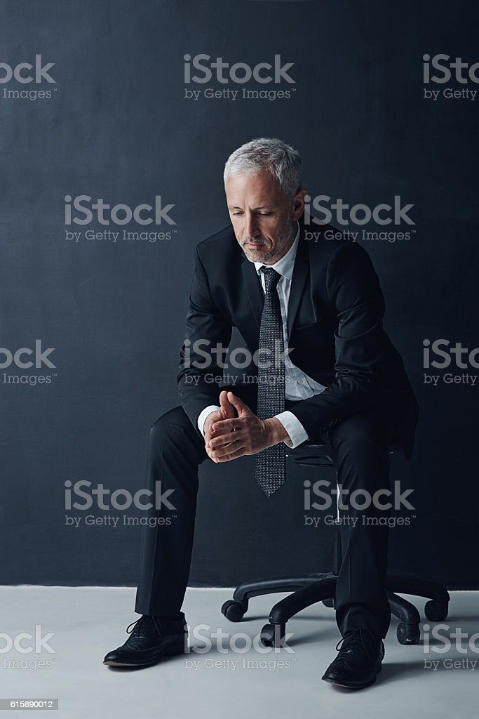 He's responsible for making difficult decisions stock photo