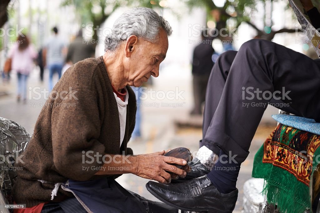 He's the best shoeshine on this street stock photo