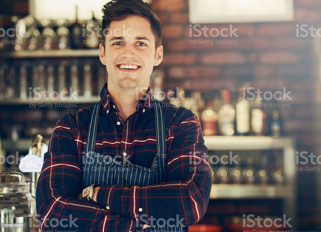 He's the proud owner of a new restaurant stock photo
