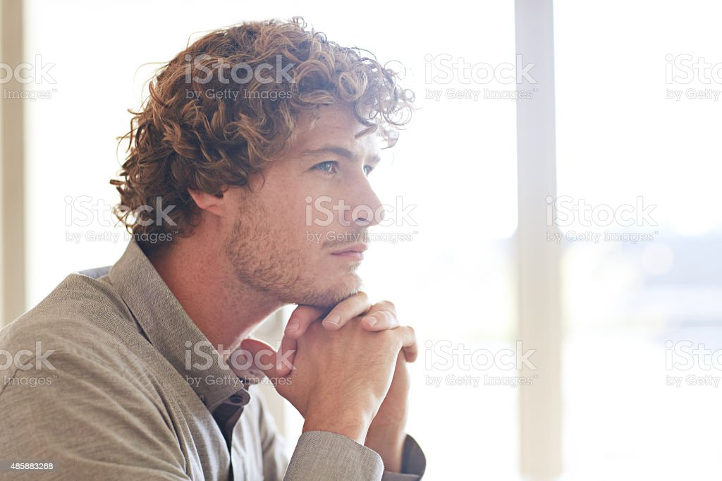 He's working on some grand ideas stock photo