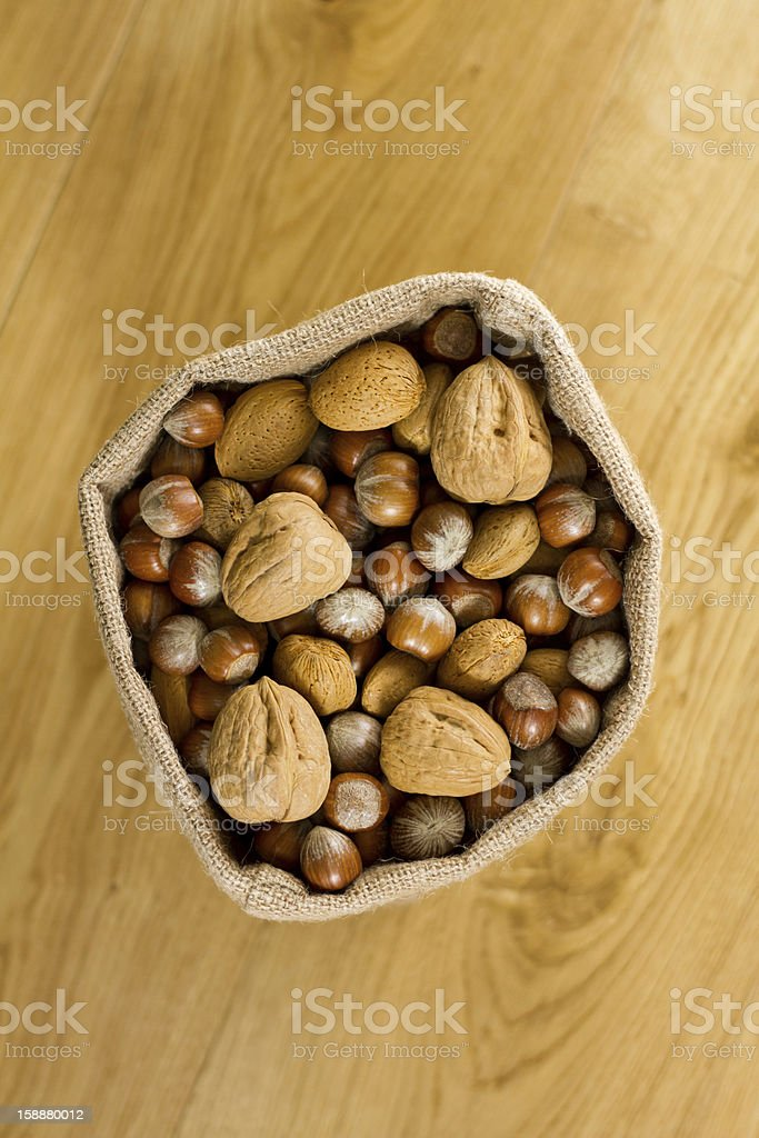 Hessian sack full of nuts from above royalty-free stock photo