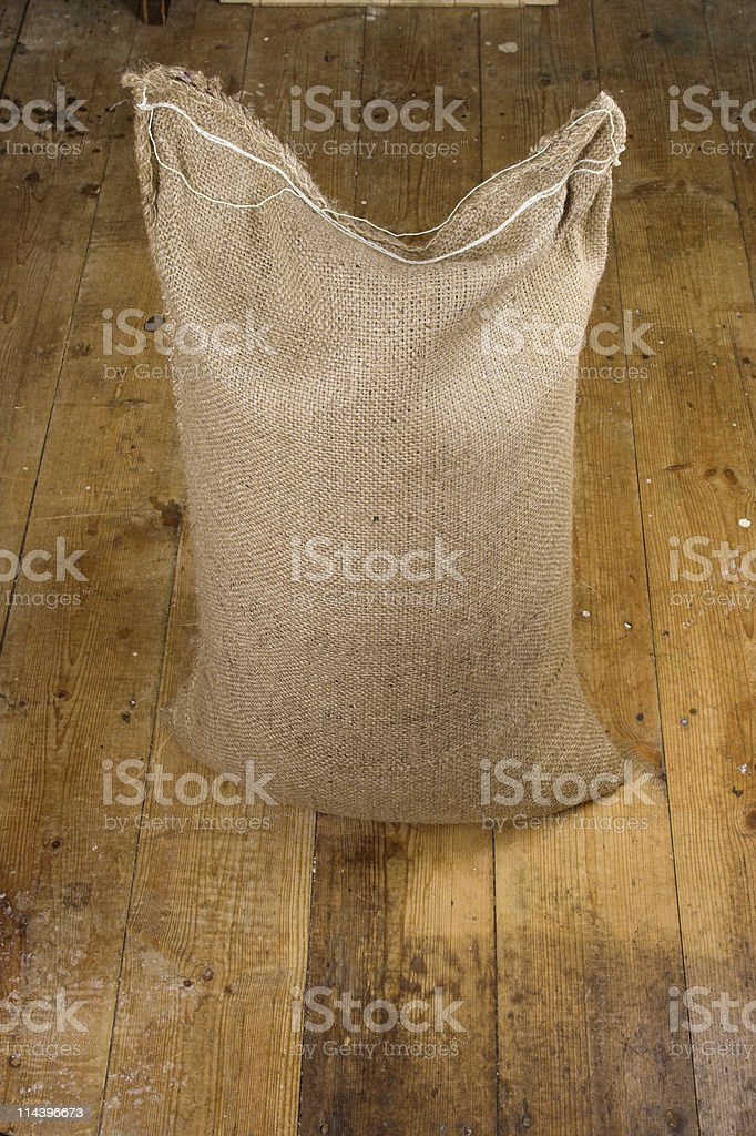 Hessian Sack On Old Wooden Floor royalty-free stock photo