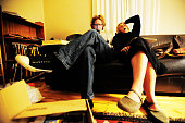 Heterosexual couple sits bored on couch