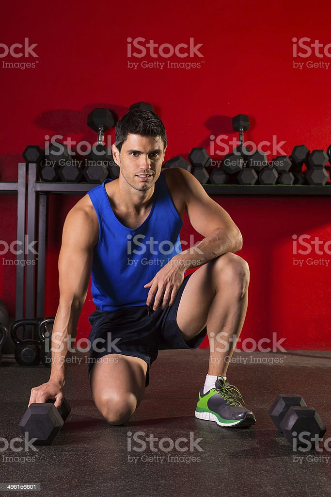 Hex dumbbells man workout in red gym royalty-free stock photo