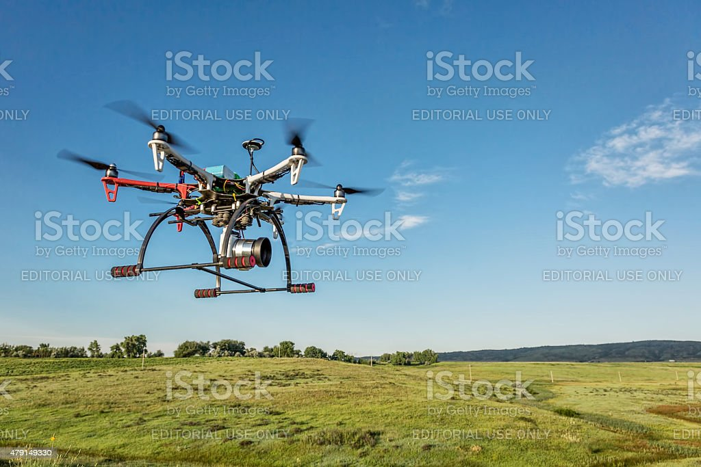 hexacopter drone flying with camera stock photo