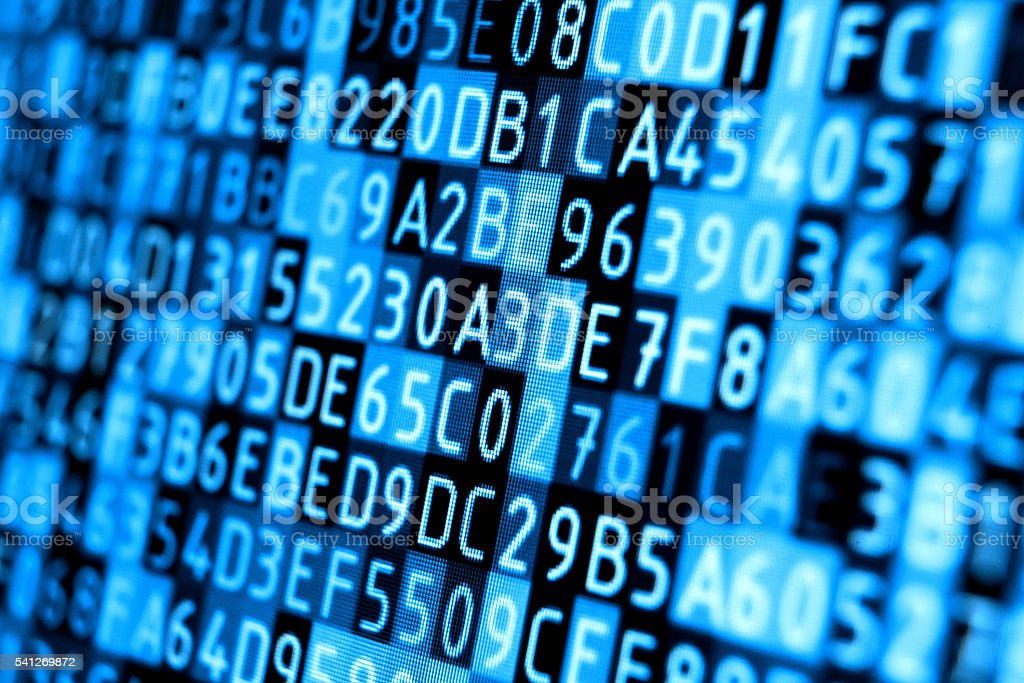 Hexadecimal code detail on computer monitor, blue background stock photo